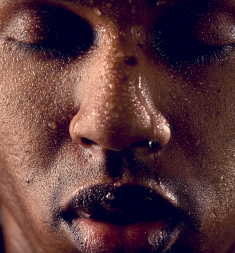 drops of water on face of black guy
