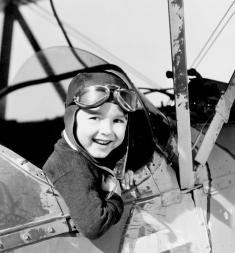 Little boy in cockpit of plane